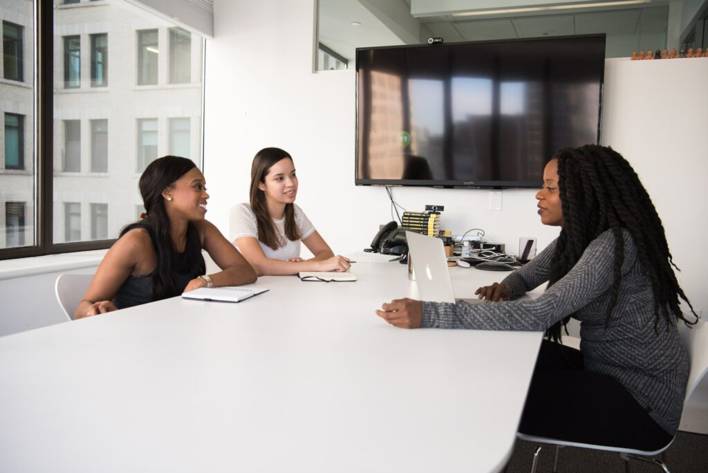 Three women in a meeting © christina www.wocintechchat.com unsplash